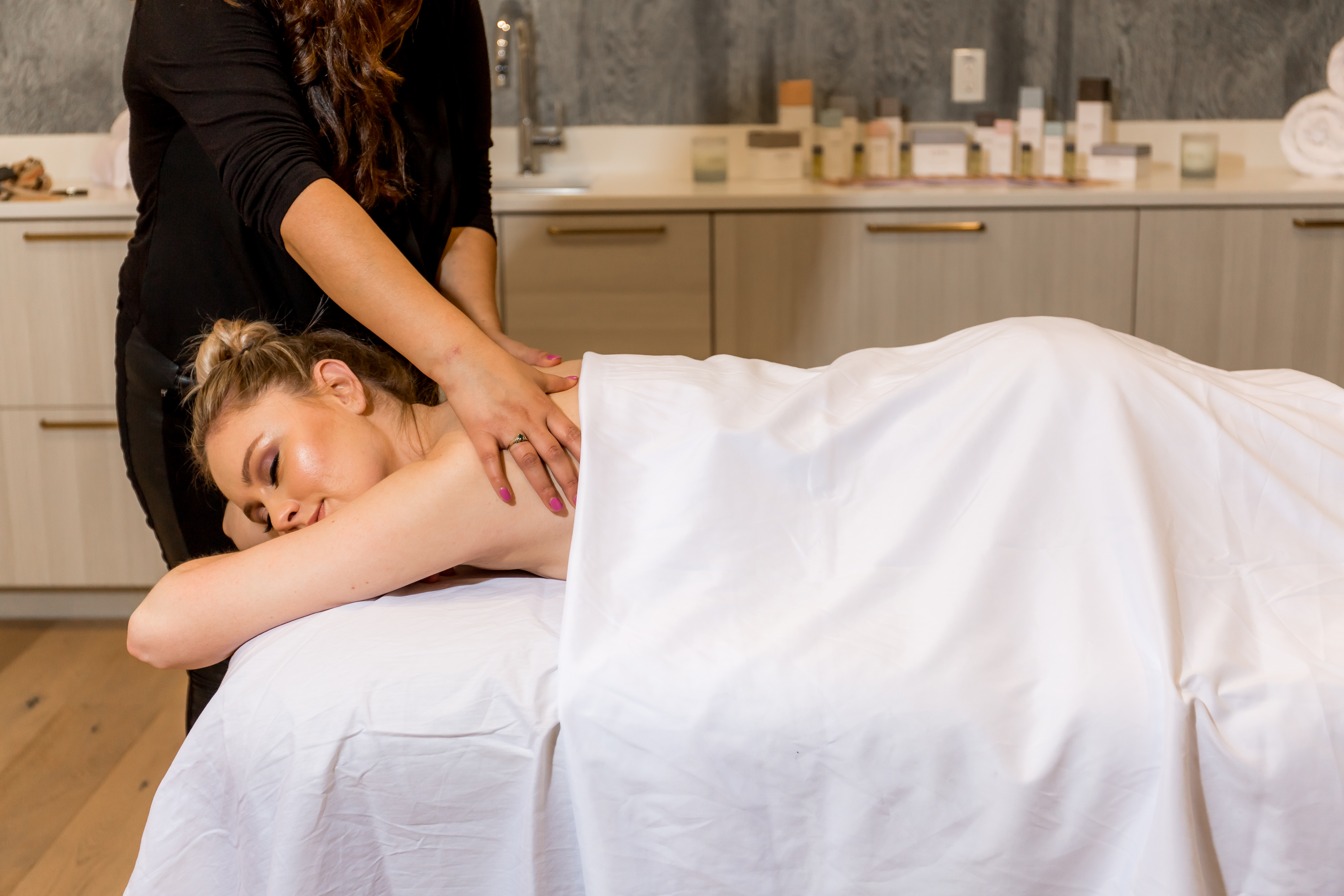 Girl indulging in the spa day a la carte service option with an in-house massage.